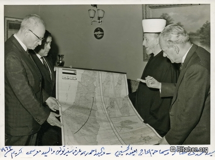 1963 - Studying the map of Palestine.jpg